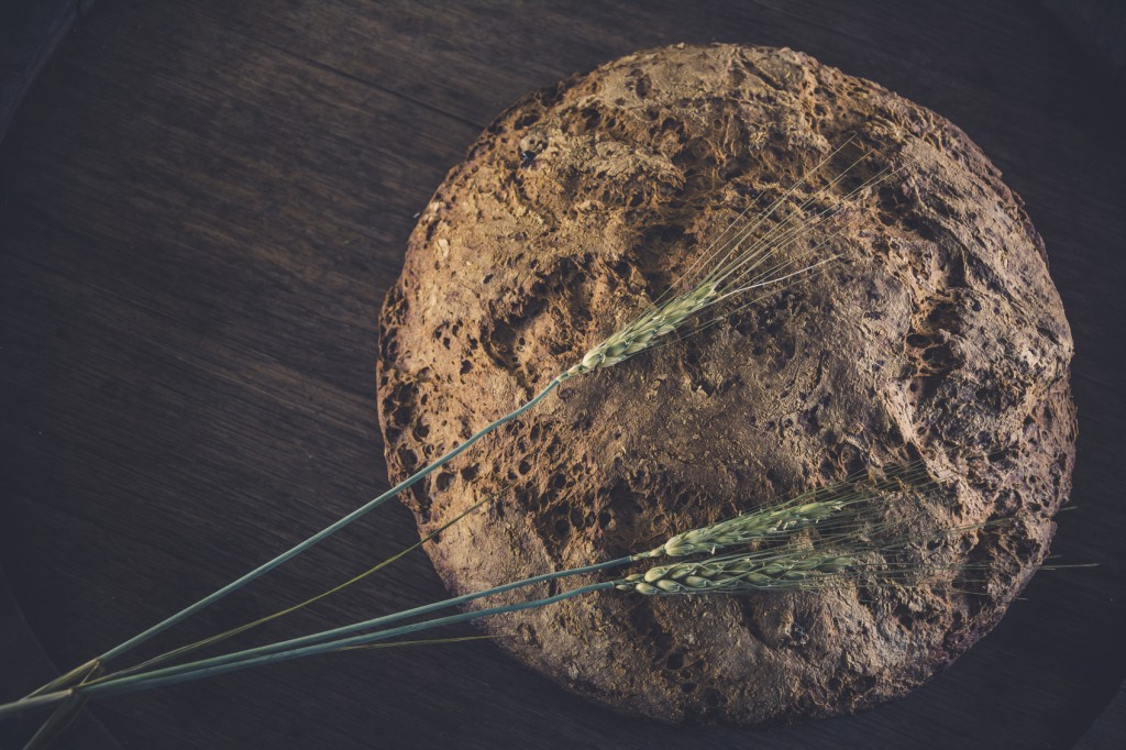Homemade bread without yeast, gluten-free, baking powder. Eco bread with flax seeds and raisins made from rye flour.
