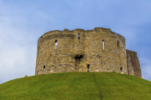 Clifford's Tower, York Castle. In 1068, King William ordered a motte and bailey castle here. Some claim built in 8 days. Ironically, Vikings of Denmark with help from York rebels burned down the motte and bailey castle. The stone fortress came later.